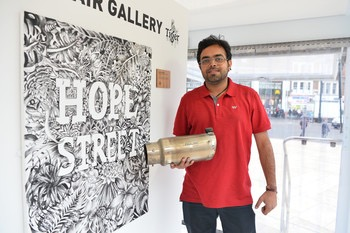 7062-Inventor_Anirudh_Sharma_pictured_with_his_Air_Ink_technology_inside_the_Tiger_Beer_Clean_Air_Gallery_in_Brixton_London_.JPG.350x0.jpg