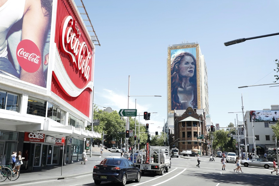 BINGE unravels 18-storey hand painted portrait of Nicole Kidman in Sydney via Thinkerbell
