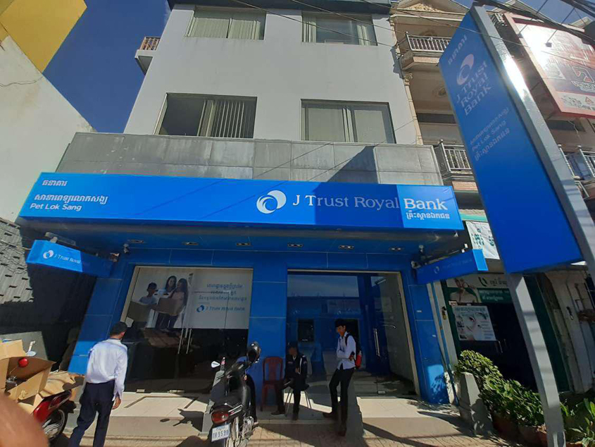 Comzone Cambodia performs mission possible for J Trust Royal Bank re-branding exercise