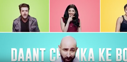 Brush Them Well says the singing dentist in a campaign from FoxyMoron for New Colgate Total in India