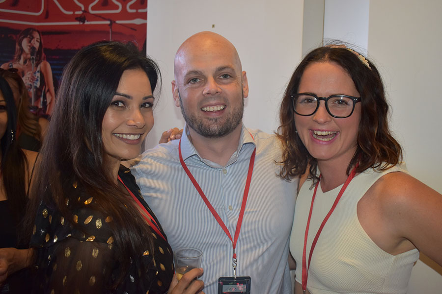 Clients and friends celebrate with Nova 93.7 at their annual Christmas Party on the balcony